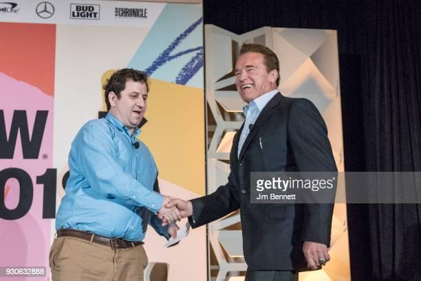 Politico Chief Washington Correspondent EdwardIsaac Dovere greets actor and former governor of California Arnold Schwarzenegger as they prepare to...