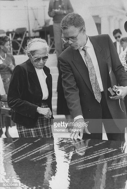 Politico Julian Bond w. Rosa Parks at civil rights monument designed by architect Maya Lin, during ceremony dedicating monument at Southern Poverty...