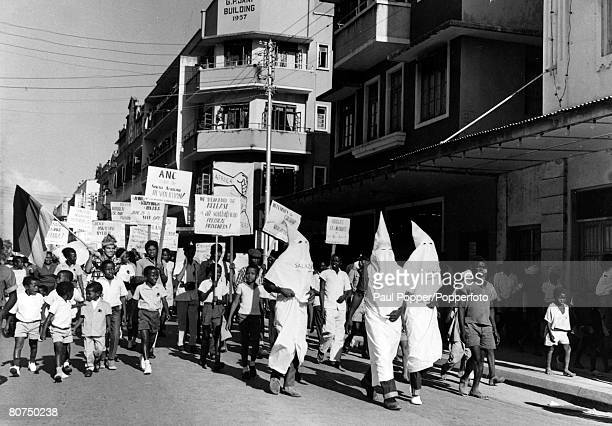 27th June 1965 African demonstrators members of the African National Congress marching through DaresSalaam some dressed as white Ku Klux Klan men in...