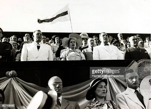 Politics Argentina South America Argentine President Juan Peron right wearing bow tie with his wife Eva at a Buenos Aires military parade 1952