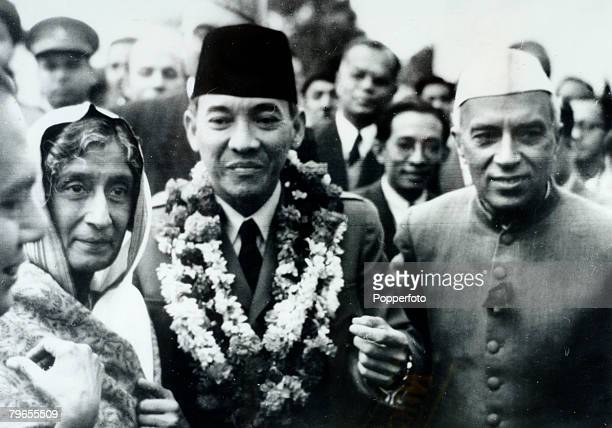 30th January 1950 New Delhi The garlanded President Ahmed Sukarno of Indonesia pictured with Indian Prime Minister Pandit Nehru