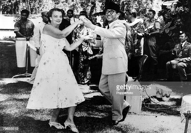 August 1959 President Ahmed Sukarno of Indonesia dances with Mrs Howard PJones wife of the US Ambassador during an informal garden party