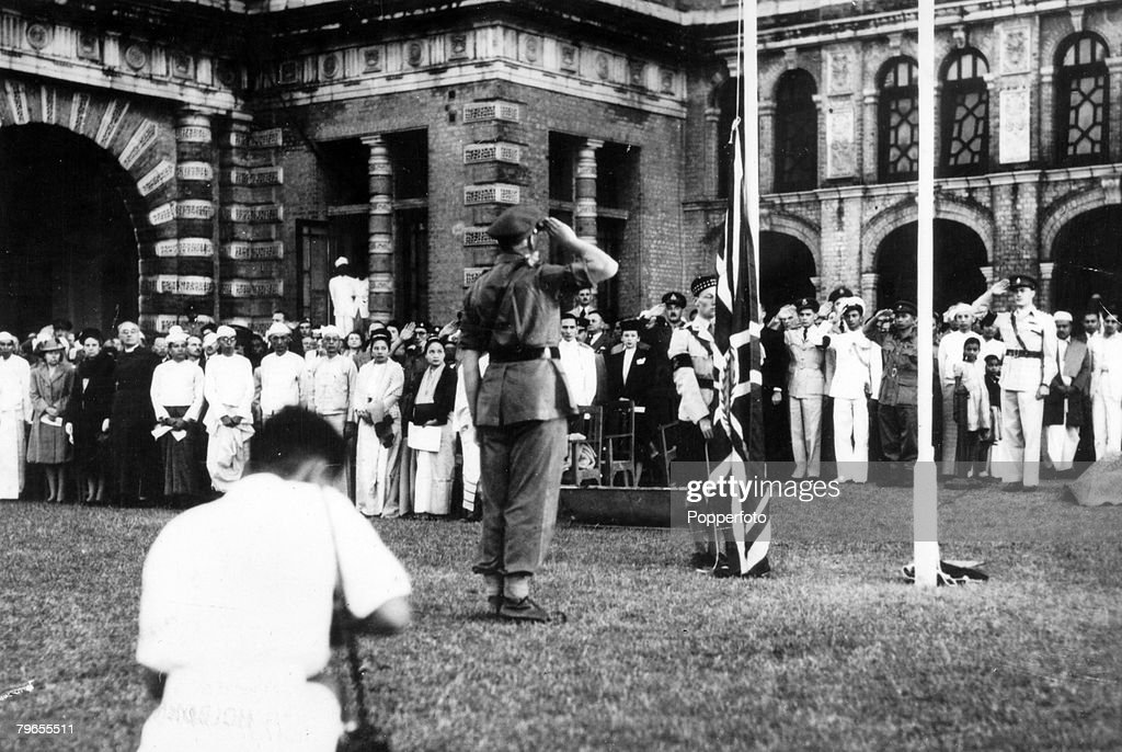 January 1948, Rangoon, The peacock centred Union Jack is lowered as Burmese ministers and Sir Hubert Rance, right,look on as Burma receives it's independence