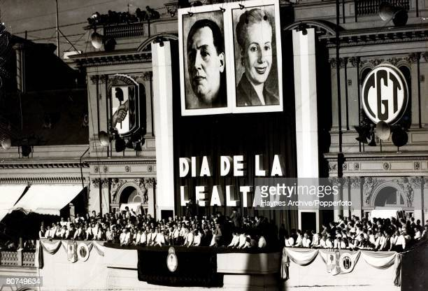 Politics Circa 1954 A picture of the Argentina dictator Juan Peron making a speech under a gaint poster of himself and Eva Peron