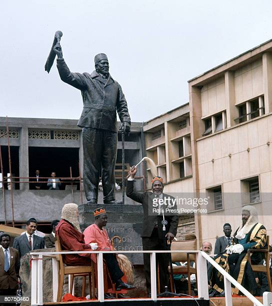 Politics Colonial Rule to Independence Africa Kenya pic 1963 Independence Ceremonies Kenyan President Jomo Kenyatta stands at the foot of the statue...