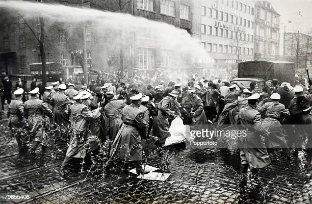 Politics Frankfurt Germany A water cannon assists riot police in controlling a protest by left wing students demonstrating against delivery of Axel...