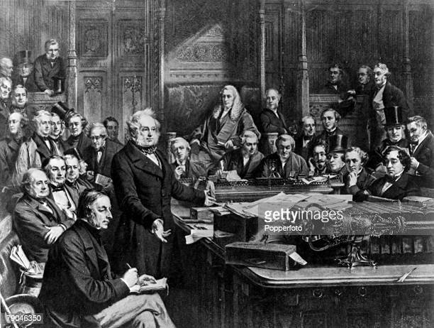circa 1860's A scene in the House of Commons with William Gladstone speaking alongside Lord Palmerston with Benjamin Disraeli on the other side of...