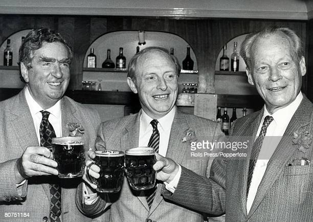 Politics, London, England Enjoying a beer at a Labour Party press conference are Dennis Healey, opposition spokesmen on Foreign Affairs, Labour...
