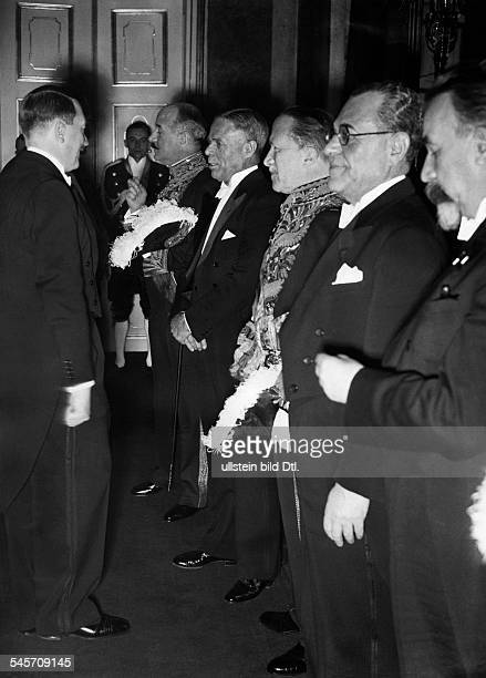 Politics New Year reception by Adolf Hitler at Reichspraesidentenpalais in Berlin AdolfHitler in conversation with diplomats from left Andre...