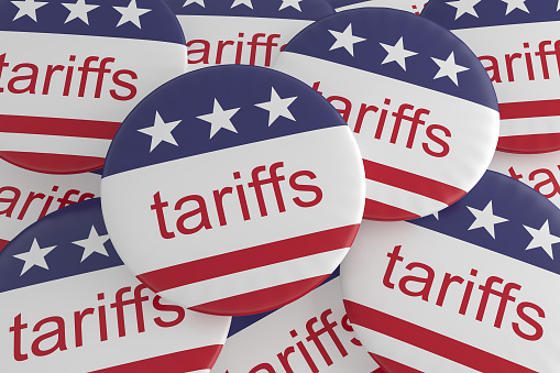 USA Politics News Badges: Pile of Tariffs Buttons With US Flag, 3d illustration 931412604