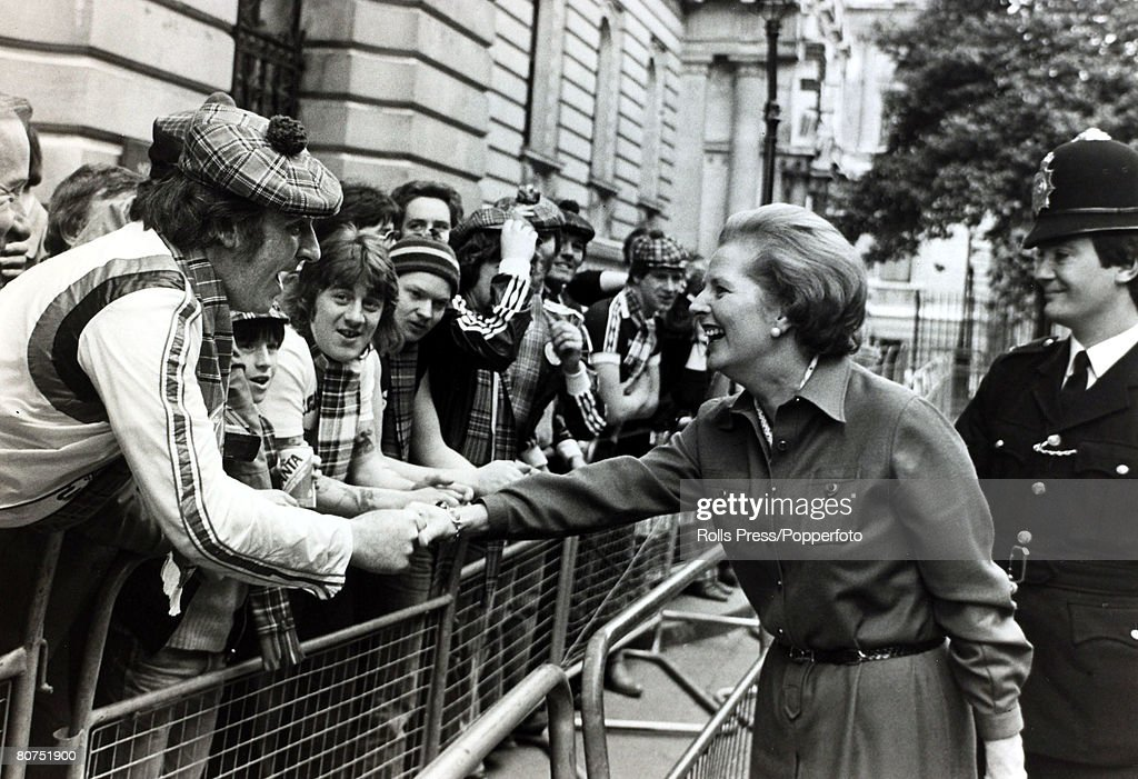 29th May 1979, London, England, British Prime Minister Margaret Thatcher greets Scotland football fans in Downing Street, as they arrive in London for the England v Scotland match, Margaret Thatcher, (born 1925) English Conservative politician, who in 1979 became the first woman to be Prime Minister of Great Britain