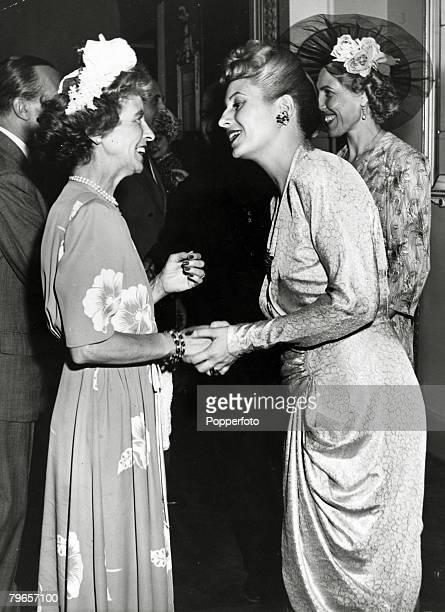 July 1947 Rome Italy Eva Peron 19191952 the wife of the Argentine President centre pictured while on her European tour meets Mss Dunn