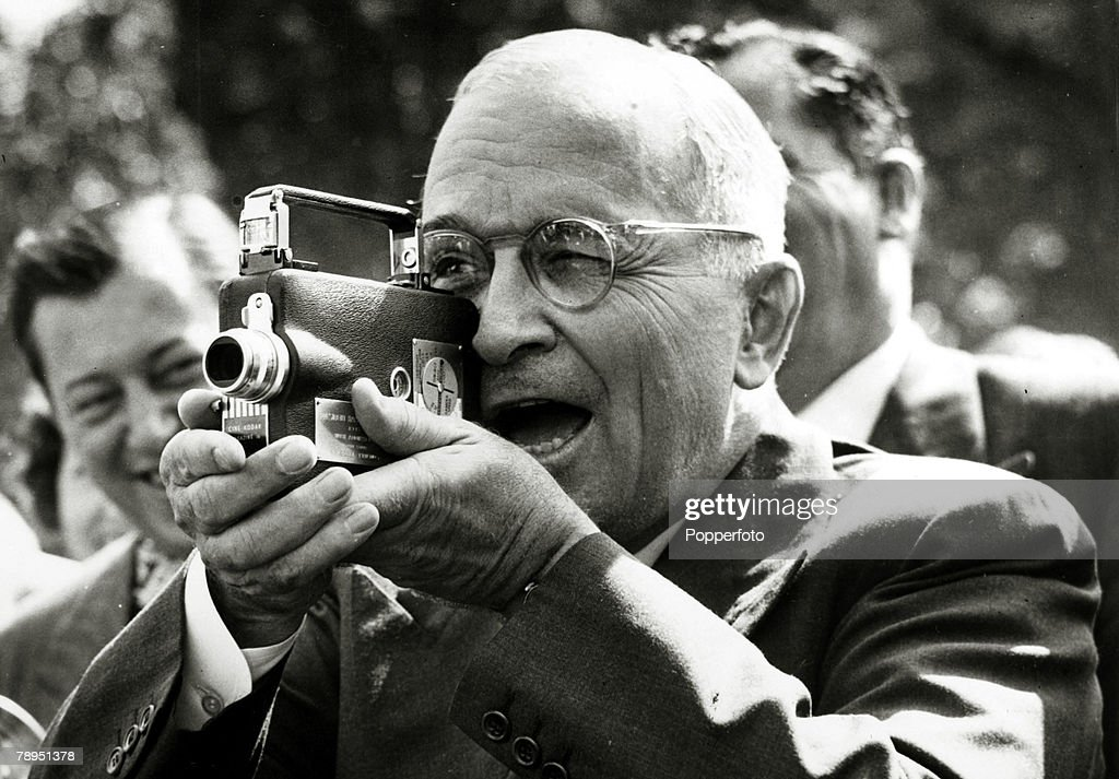 Politics. Personalities. USA. pic: 1948. Washington. President Harry S. Truman tries out a miniature movie camera, presented to him by the White House Press Corps. President Truman (1884-1972) became the 33rd President of the United States 1945-1953. : News Photo