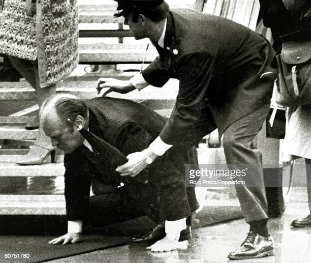 1975 President Gerald Ford slips and falls as he arrives at Salzburg Airport Austria as a US military aid moves in to assist Gerald Ford became the...