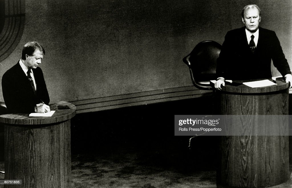 Politics Personalities. USA. pic: 1976. Democratic Presidential candidate Jimmy Carter takes notes as President Gerald Ford answers questions during their debate before the nation. Jimmy Carter (born 1924) became the 39th President of the United States 1 : News Photo
