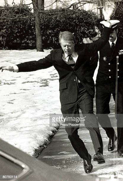 1976 President Jimmy Carter slips and almost falls as he negotiates an icy path as he leaves the White House Washington Jimmy Carter became the 39th...