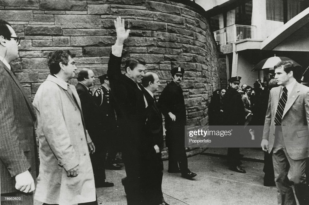 Politics. Personalities. USA. pic: 30th March 1981. Washington D.C. President Ronald Reagan waves shortly before he was shot by a would be assassin. Presidential Secretary James Brady and a policeman were also shot as an attempt on President Reagan's life : News Photo