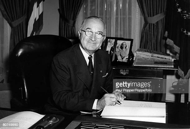 circa 1952 President Harry S Truman pictured signing the ratification treaty which will make Japan a free nation again Harry STruman became the 33rd...
