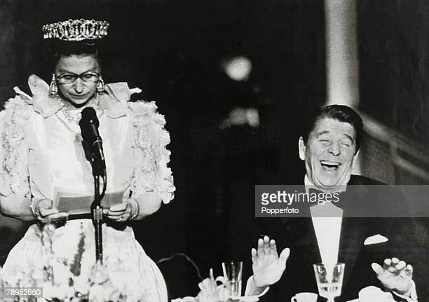 March 1983 San Francisco President Ronald Reagan roars with laughter at a joke delivered 'deadpan' style by HMQueen Elizabeth which remarked on the...