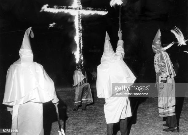 Hemingway, South Carolina, A Ku Klux Klan night rally with Klansmen burning their wooden cross, as they hold their fiery torches