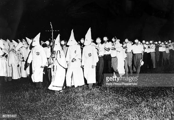 circa 1960's USA A Ku Klux Klan swearing in ceremony with new members marching past