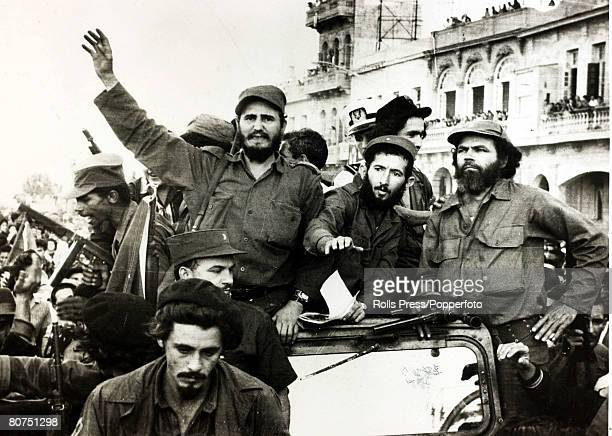 Politics / Revolution Personalities pic January 1959 Cuban rebel leader Fidel Castro arm raised in triumph as he enters Havana with his bodyguard...