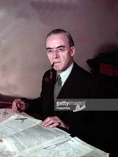 Politics Sir Stafford Cripps Minister of Econimic Affairs pictured at his desk London 1947