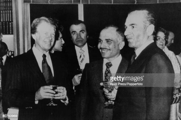 Politics Tehran Iran 1978 American President Jimmy Carter Jordanian King Hussein and Mohammad Reza Pahlavi The Shah of Iran share a drink at the...
