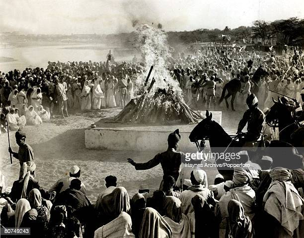 Politics The funeral pyre of Indian political and spiritual leader Mahatma Gandhi as police keep back large crowd Delhi India 1948