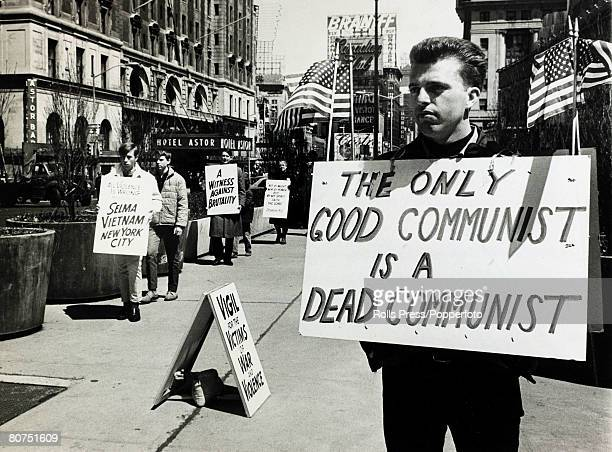 17th April 1965 New York A anticommunist picket with a stark message as a rival demonstration peacefully moves alongside with it's message of peace...