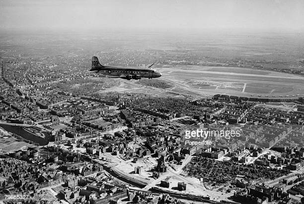 Politics War and Conflict Transport pic May 1949 Berlin A relief aircraft over the city prepares to land at Berlin's Templehof Airport The airlift...