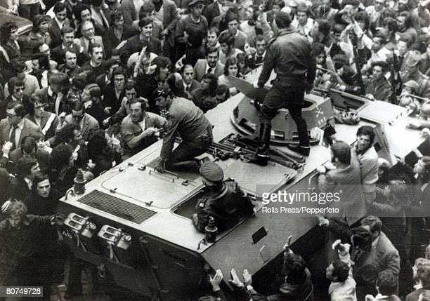 26th April 1974 Lisbon Crowds try to stop a tank carrying three members of the former DGS who had escaped earlier as the military junta had...