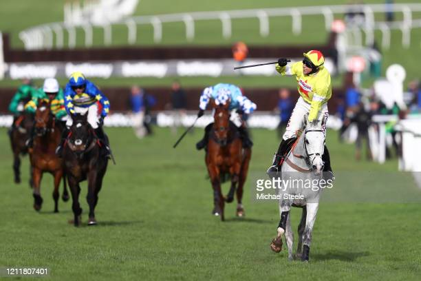 Politologue ridden by Harry Skelton celebrates winning the Betway Queen Mother Champion Chase at Cheltenham Racecourse on March 11, 2020 in...