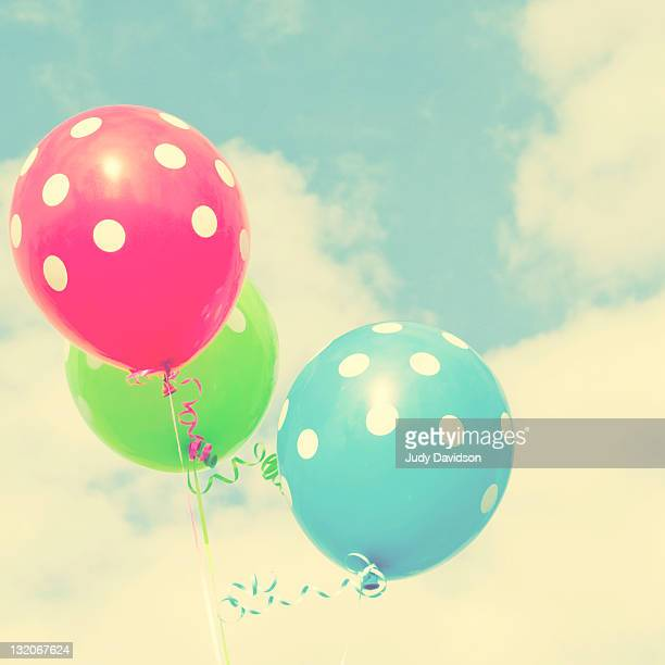 Polka dot balloons against blue sky and Clouds