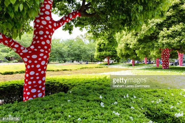 Polka Dot Decorated Tree Trunks at The National Art Centre, Tokyo. An Art Installation by Yayoi Kusama.
