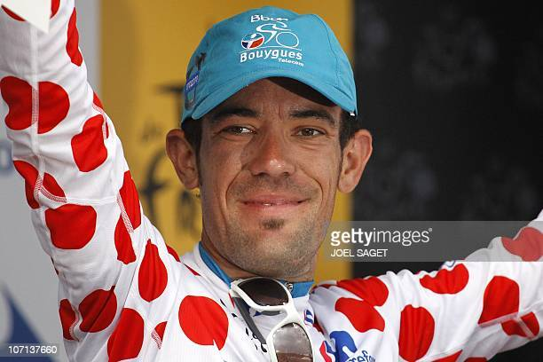 Polka dot jersey of Best climber, France's Anthony Charteau, celebrates on the podium at the end of the 210,5 km and 12th stage of the 2010 Tour de...