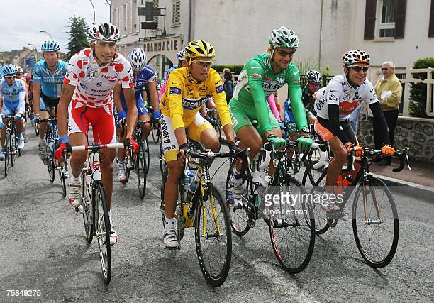 Polka Dot King of the Mountains jersey winner Juan Mauricio Soler Hernandez of Colombia and Barloworld, Yellow Jersey Alberto Contador of Spain and...