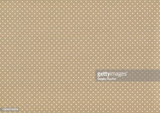 polka dot on beige paper as an abstract background - spotted stock pictures, royalty-free photos & images