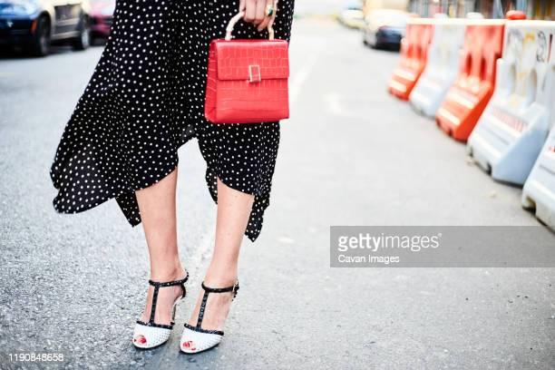 polkadot street fashion - handbag stock pictures, royalty-free photos & images