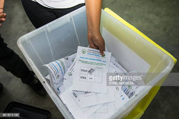 A poll agent removes ballots papers for counting on December 18 2015 in an election office in Kigali Rwanda counted votes on December 18 2015 after...