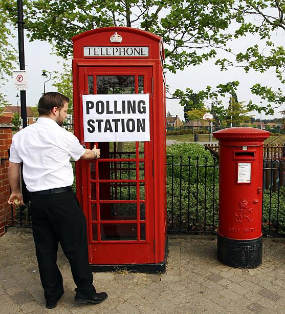 A Poll Clerk Ensures The Door To Telep