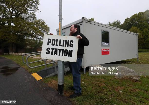A poll clerk sets up a polling station within a Portakabin in Ashford Kent as voters got to the polls for the local elections