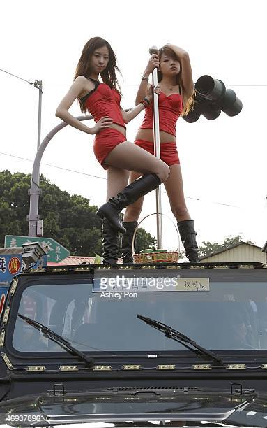 Poll dancers take part in the annual Yanshuei Beehive Rockets Fireworks Festival on February 14, 2014 in Tainan, Taiwan. The festival, 15 days after...
