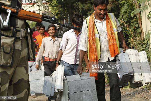 Poll officials on their way to polling booth from Golghar for the third phase of the ongoing Bihar Assembly Elections on October 27 2015 near Patna...