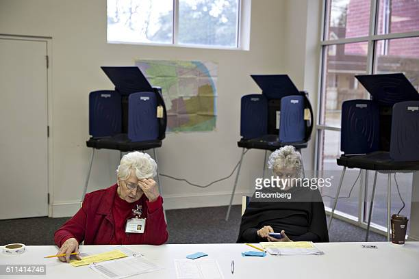 Poll volunteers sit at a voter registration table inside Brookland United Methodist Church in Columbia South Carolina US on Saturday Feb 20 2016 With...