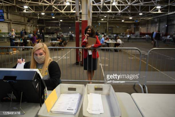 Poll watcher monitors the counting of ballots at the Allegheny County elections warehouse on November 6, 2020 in Pittsburgh, Pennsylvania. Counting...