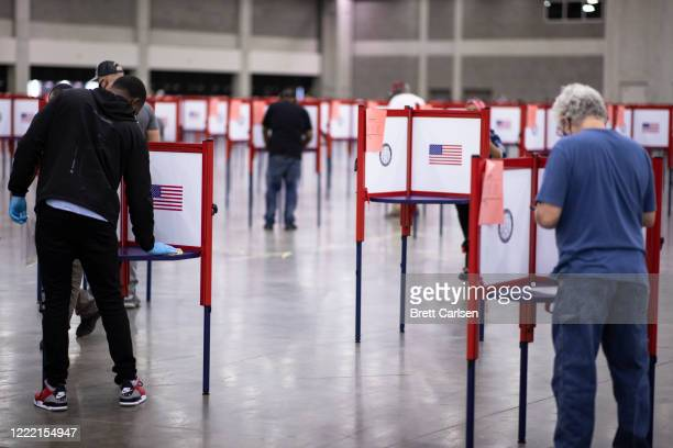 Poll worker cleans a voting booth between voters during Tuesdays primary election on June 23, 2020 in Louisville, Kentucky. The Kentucky Exposition...