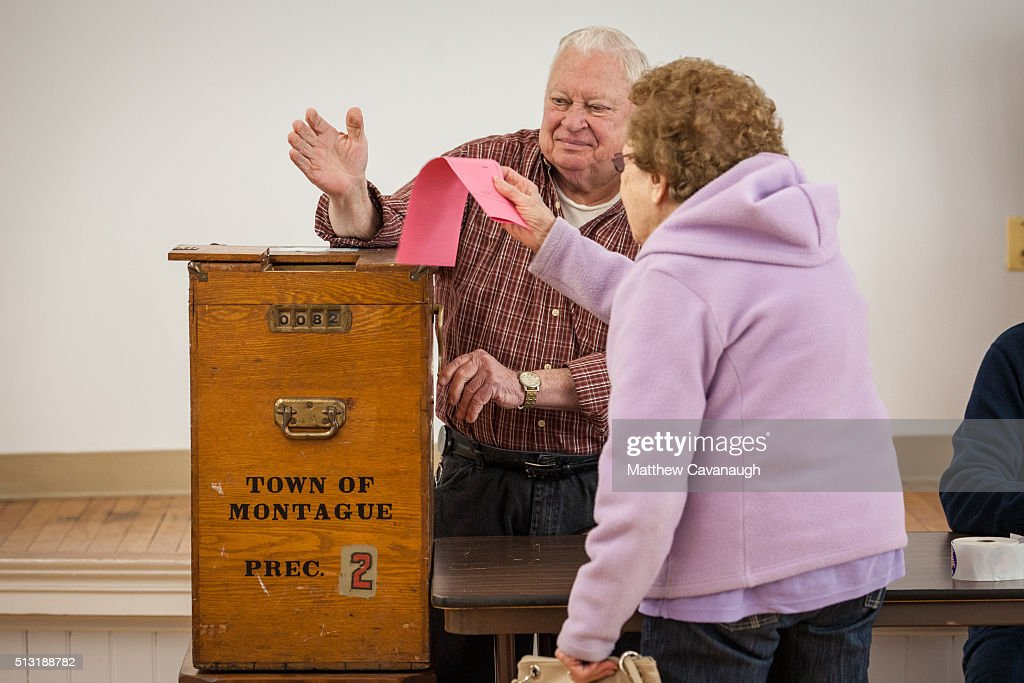Poll worker John Mayrand mans a manual, crank operated, ballot box on March 01, 2016 in Montague, MA. Officials are expecting a record turnout of voters in Massachusetts, one of a dozen states holding Super Tuesday presidential primaries or caucuses.