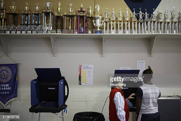 A poll worker left gives instructions to a firsttime voter at a polling station inside Spartanburg High School during the South Carolina Democratic...