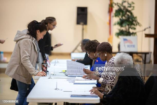 A poll worker prepares a paper ballot at East Stonewall AME Church during the North Carolina primary on Super Tuesday in Charlotte North Carolina on...